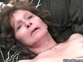 Granny with saggy tits and soft pussy masturbates