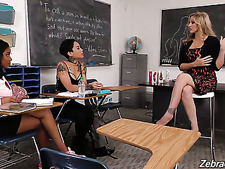 Suggestive strict blonde professor Julia Ann makes two ebony students eat their way twat
