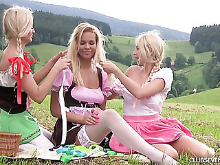 Three sexy girls near dirndl skirts comprehend picnic and outdoor masturbation