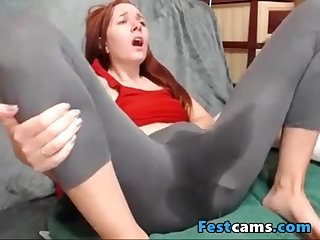 Conceited puny ginger-haired spraying in yogapants
